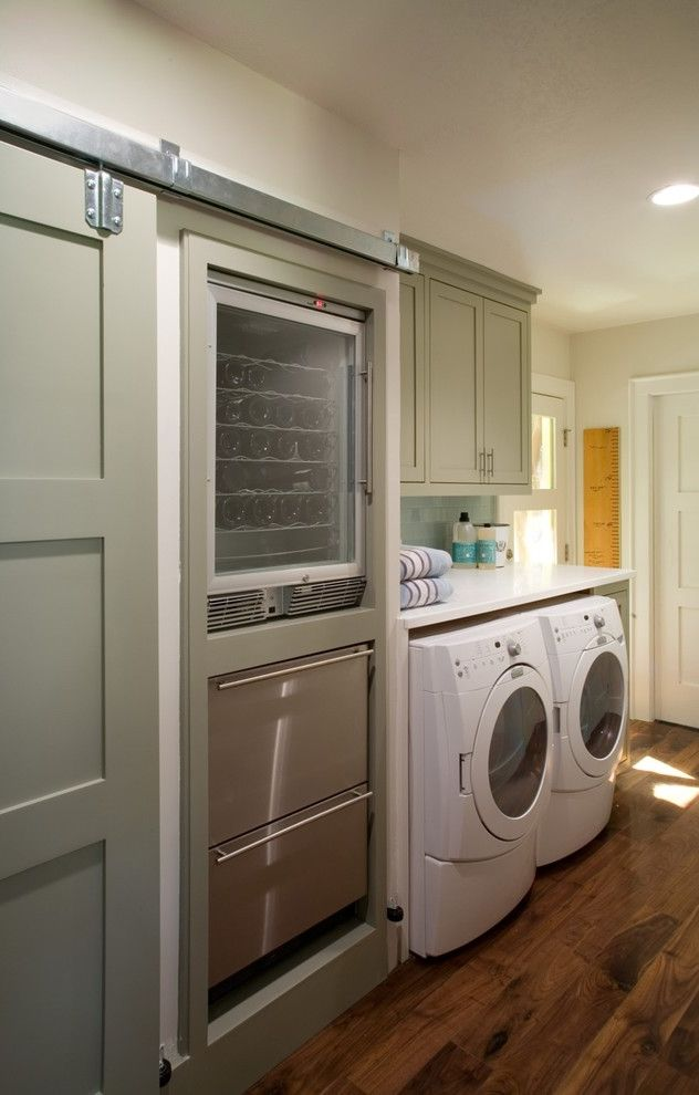 Undercounter Freezer with Ice Maker   Traditional Laundry Room Also Barn Door Built Ins Front Loading Washer and Dryer Green Cabinets Laundry Room Pantry Shake Cabinets Shaker Style Door Wine Storage Wood Floors