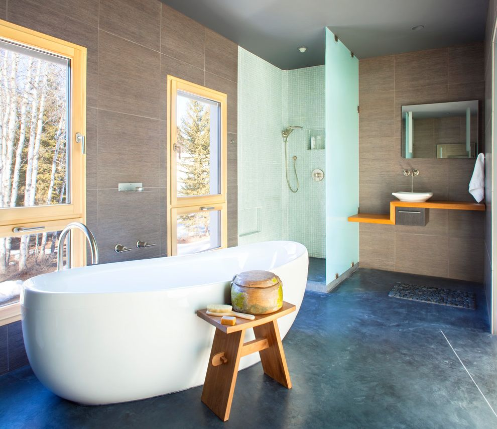 Unilux Windows with Contemporary Bathroom and Accent Stool Bathtub Concrete Floor Bathroom Floating Shelf Frosted Glass Glass Shower Glass Shower Enclosure Mirror Neutral Walls Soaking Tub Tile Walls Wood Trim