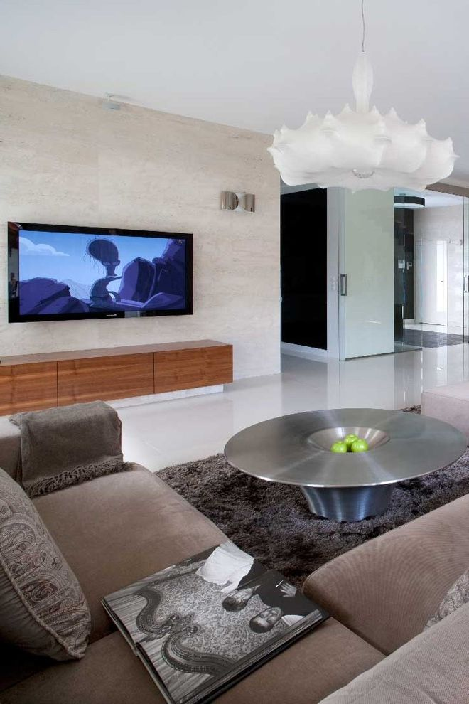 Unique Tv Consoles with Modern Living Room Also Area Rug Glass Door Media Console Neutral Colors Seating Area Sofa Stainless Steel Coffee Table Suspension Light Tile Walls Tv Wood Grain