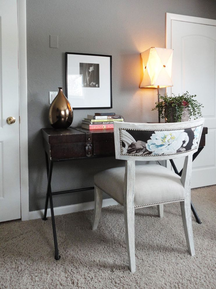Upholstered Desk Chair with Wheels   Eclectic Home Office  and Art Artwork Bronze Vase Carpet Chair Desk Floral Chair Gray Wall Grey Wall Nailhead Chair Table Lamp Trunk Table Upholstered Chair White Carpet White Trim