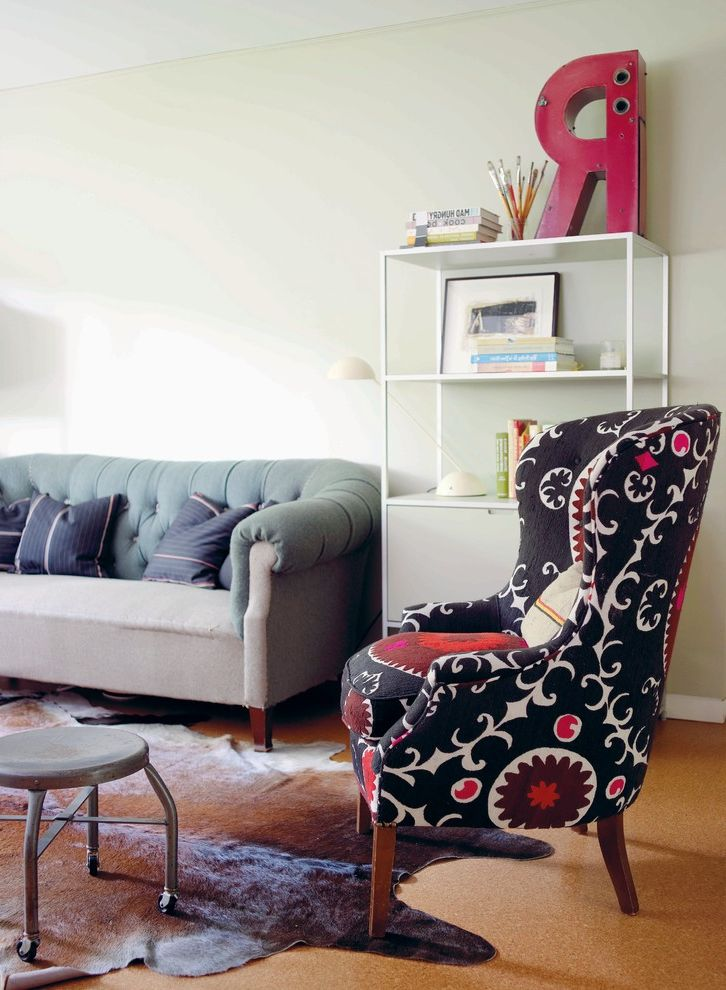 Upholstery Repair Near Me   Eclectic Living Room Also Bookshelf Chesterfield Sofa Cowhide Rug Graphic Letter Reading Light Stool on Castors Suzani Chair Tufted Sofa