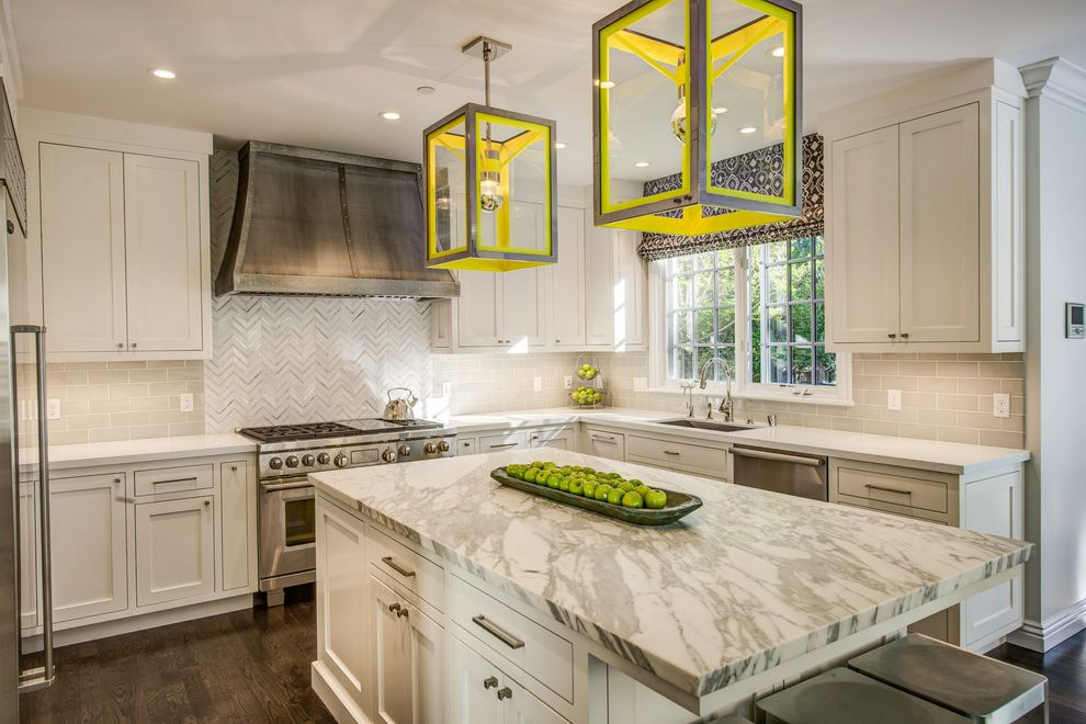 Urban Electric Company   Transitional Kitchen Also Bright Yellow Accents Herringbone Tile Kitchen Island Kitchen Isle Lighting Molding Trim Painted Window Trim Roman Shade Stone Counters White Countertop White Tile Yellow Pendant Lights