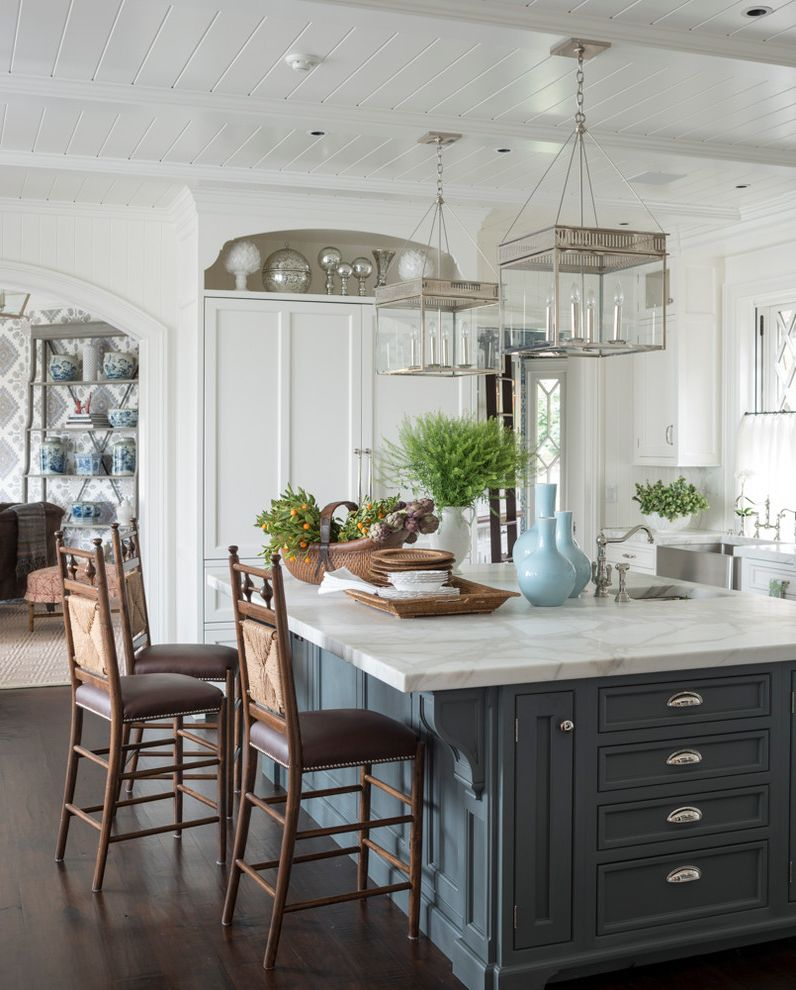 Urban Electric Company with Traditional Kitchen Also Arched Opening Beamed Ceiling Blue and White Blue Island Brackets Island Sink Niche Paneled Refridgerator Pendant Lighting Stainless Steel Farm Sink Tongue and Groove White Kitchen