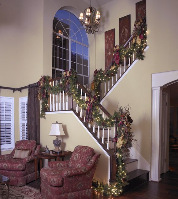 Uttermost.com   Traditional Staircase  and Christmas Decor Christmas Decorating Christmas Interior Design Decorating for the Holidays Garland Holiday Decor Holiday Decorating Holiday Interior Design Stair Garland Staircase Traditional Christmas