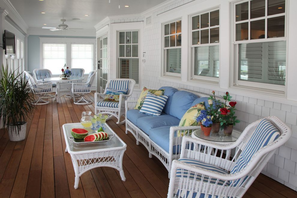 Value City Furniture Nj with Beach Style Porch  and Blue and White Striped Cushions Blue Outdoor Cushions Ceiling Fan Crown Molding Light Blue Walls Recessed Lighting Shingle Siding Sliding Glass Door Sun Room White Trim White Wicker Furniture