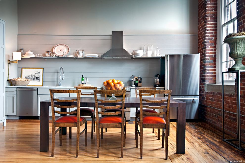 Value City Kitchen Sets   Contemporary Kitchen  and Blue Kitchen Brick Wall Eat in Kitchen Farmhouse Table Kitchen Table Loft Range Hood Stainless Steel Appliances Wood Cabinets Wood Flooring Wood Paneling