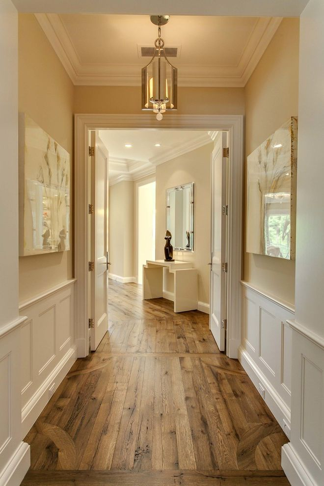 Vegas Flooring Outlet   Traditional Hall Also Baseboard Beige Walls Crown Molding Double Doors Hardwood Floor Transitional Light Fixture Wainscoting White Ceiling White Trim