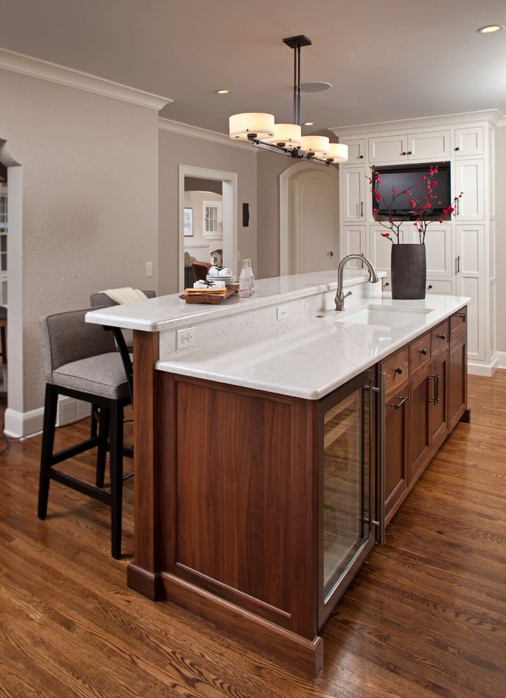 Vegas Flooring Outlet   Transitional Kitchen Also Beverage Cooler Counter Stools Custom Woodwork Frame and Panel Gray Walls Kitchen Island Oak Pendant Light Tv White Counters White Trim Wood Floor