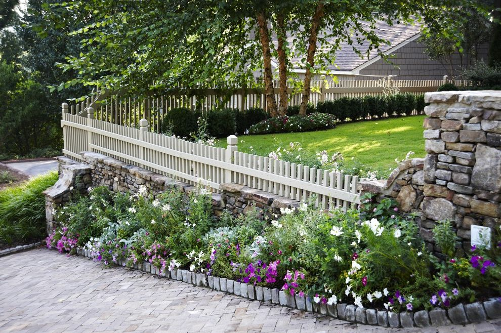 Vinyl Fencing Hawaii with Traditional Landscape  and Brick Driveway Cobblestone Edging Flower Bed Grass Landscape Lawn Perennial Garden Picket Fence Planters Purple Groundcover Stone Pillars Stone Wall Turf Wood Fence