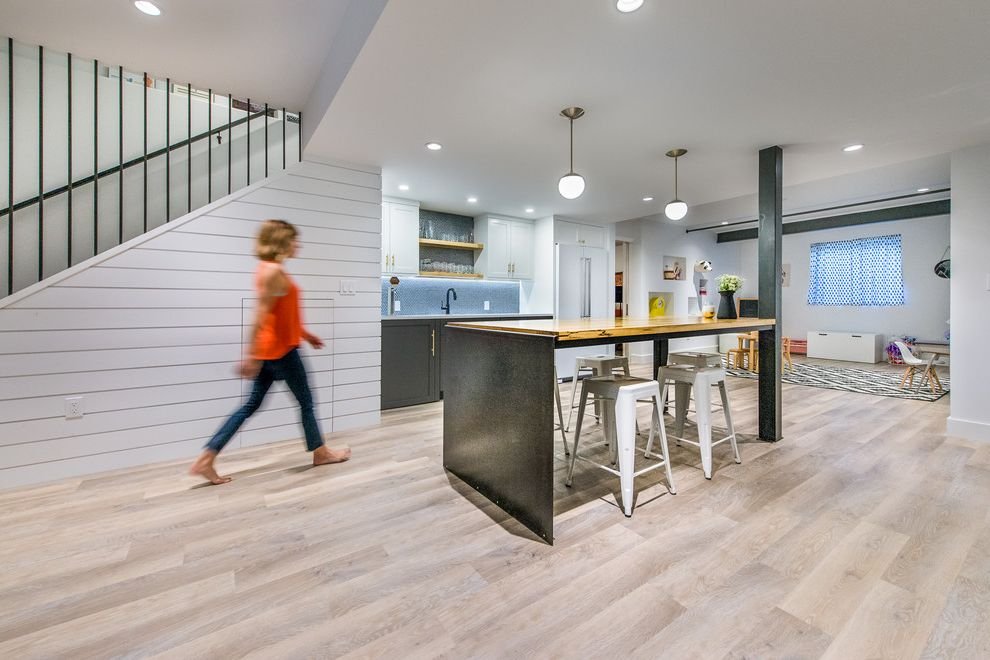 Vinyl Flooring for Basement with Transitional Spaces  and Bar Counter Stools Family Friendly Island in Basement Pendant Lights Playroom in Basement White Panel Wall