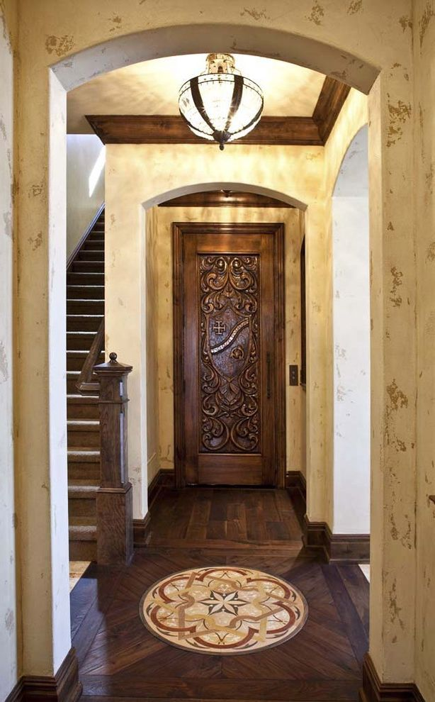 Vinyl Wood Flooring Home Depot with Traditional Hall  and Archway Carved Wood Door Ceiling Light Distressed Walls Floor Design Floor Pattern Warm Tones Wood Flooring Wood Moulding Wood Staircase