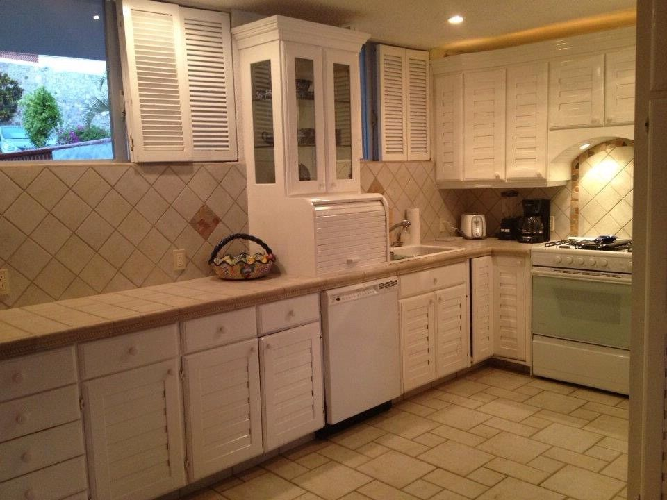 Vrbo Mexico   Beach Style Kitchen Also Cabinets Kitchen Rental Property