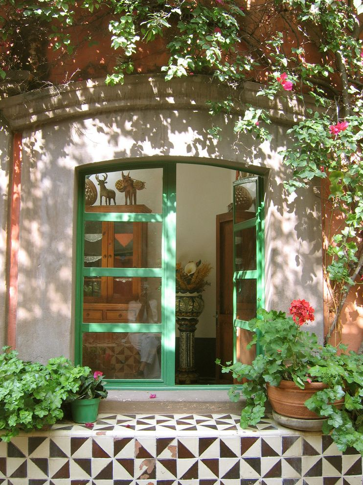 Vrbo Mexico   Mediterranean Entry  and Arched Doorway Climbing Vines Colorful Flowering Plants French Doors Green Casing Mexican Tiles Potted Plants Stucco Tile Entry