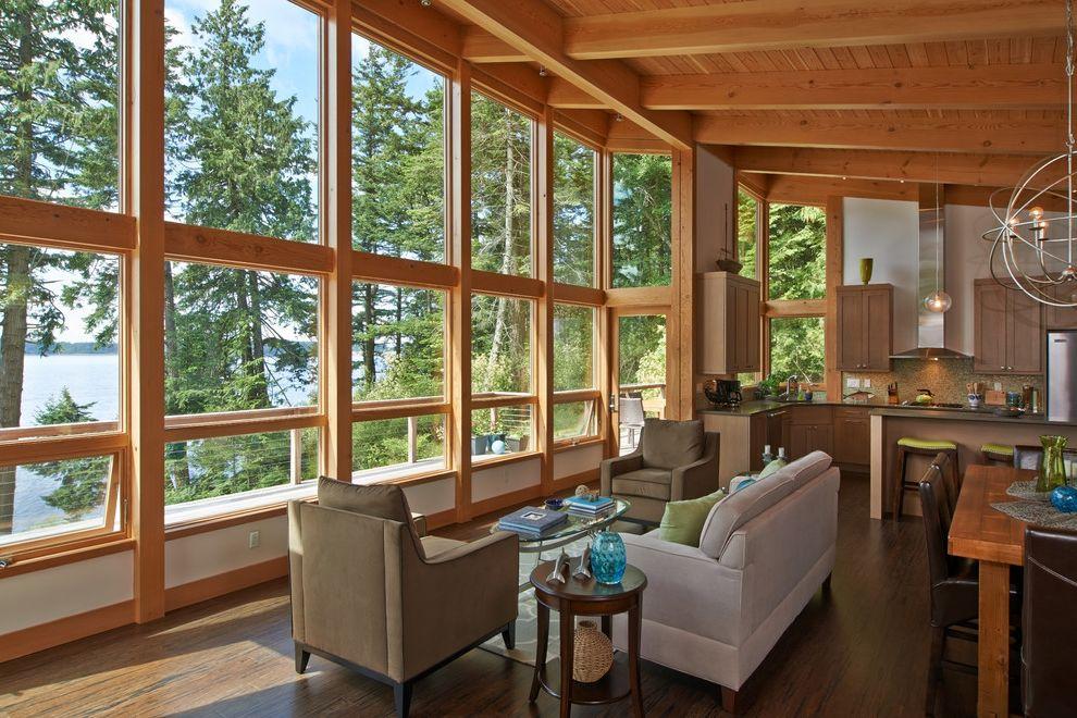 Vue at Lake Eola   Rustic Living Room  and Beige Sofa Chandelier Douglas Exposed Wood Beams Sloped Ceiling Walls of Windows Wood Ceiling Wood Trim