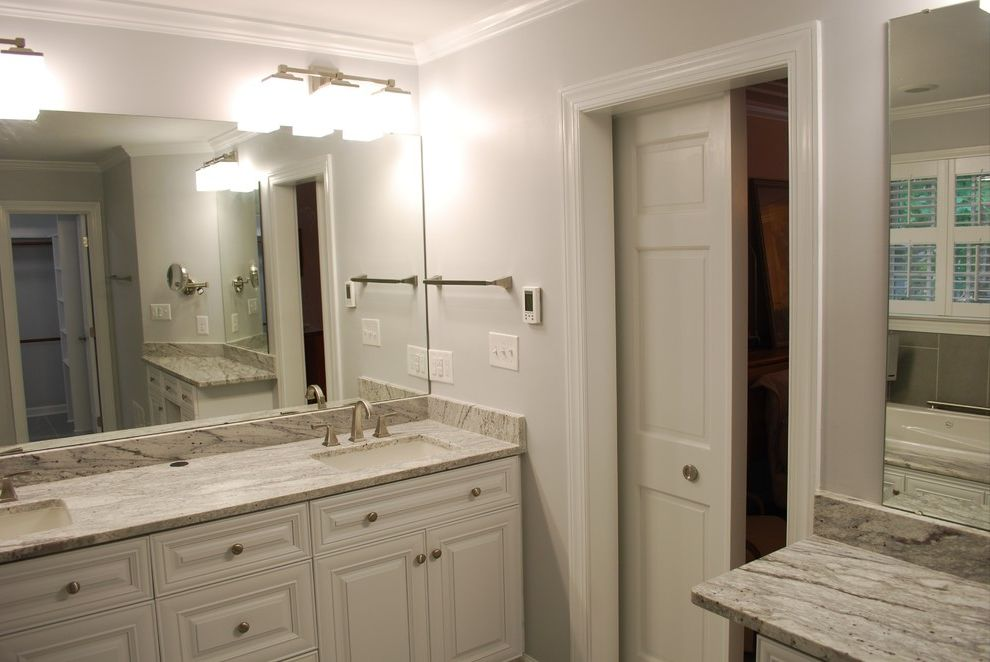 Wake Remodeling   Traditional Bathroom  and Apex Nc Barn Door Custom Cabinet Bathroom Remodel Design Frameless Shower Glass Enclosure Glacier White Granite Granite Tub Deck Heated Tile Floors Wake Remodeling