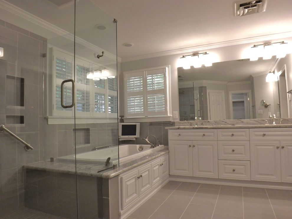 Wake Remodeling with Traditional Bathroom  and Apex Nc Barn Door Custom Cabinet Bathroom Remodel Design Frameless Shower Glass Enclosure Glacier White Granite Granite Tub Deck Heated Tile Floors Wake Remodeling