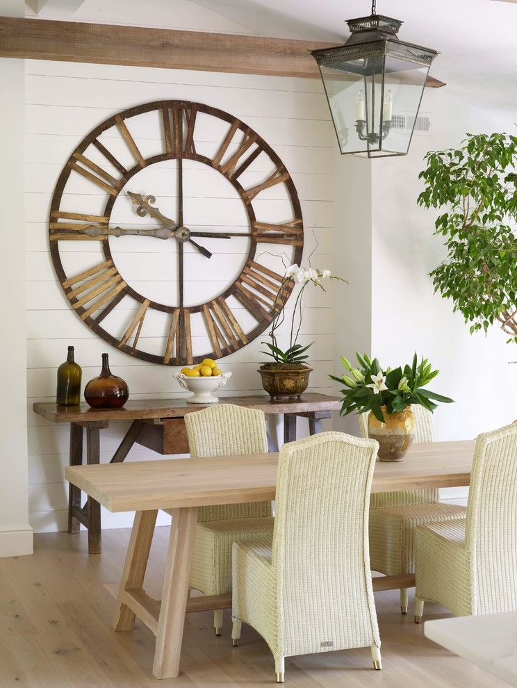 Wall Clocks with Chimes with Transitional Dining Room  and Bowl of Lemons Charming Exposed Beams Glass Jugs Indoor Tree Large Clock Light Wood Dining Table Light Wood Floor Orchid Pendant Lantern Rustic Touches Wicker Dining Chairs
