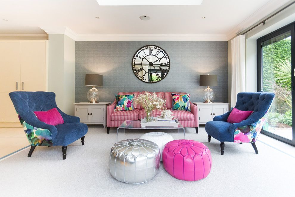 Wall Clocks with Chimes with Transitional Living Room  and Coffee Table Fabric Wall Feature Clock Glass Table Lamps Grey Feature Wall Grey Wall Mirror Clock Pink Pink and Blue Pink Striped Sofa Pouffes Side Tables Striped Sofa Tufted Chair Wall Clock