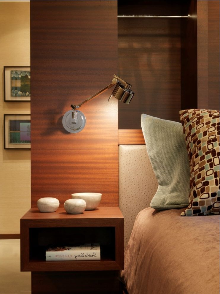 Wall Mount Plug in Lamp   Rustic Bedroom  and Bedside Table Blue and Brown Decorative Pillows Neutral Colors Nightstand Reading Lamp Swing Arm Lamp Throw Pillows Upholstered Headboard Wood Paneling