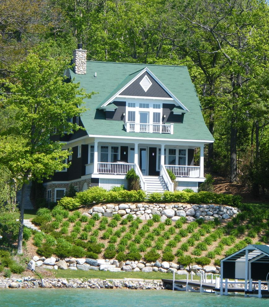 Walloon Lake Inn   Beach Style Exterior Also Balcony Boathouse Coastal Columns Cottage Dock Dormer Forest Front Porch Grass Green Roof Hillside Lakefront Lattice Lawn Slope Stone Retaining Wall Turf