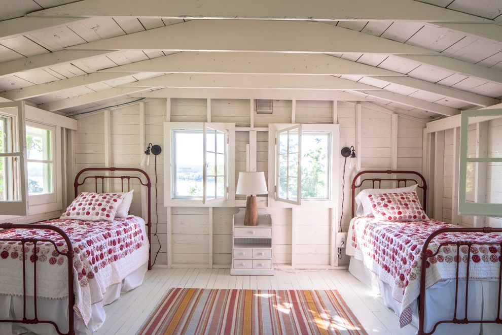 Walloon Lake Inn   Scandinavian Kids  and Cottage Style Exposed White Beams Red and Orange Rug Red Twin Bed Vaulted Ceiling White Nightstand