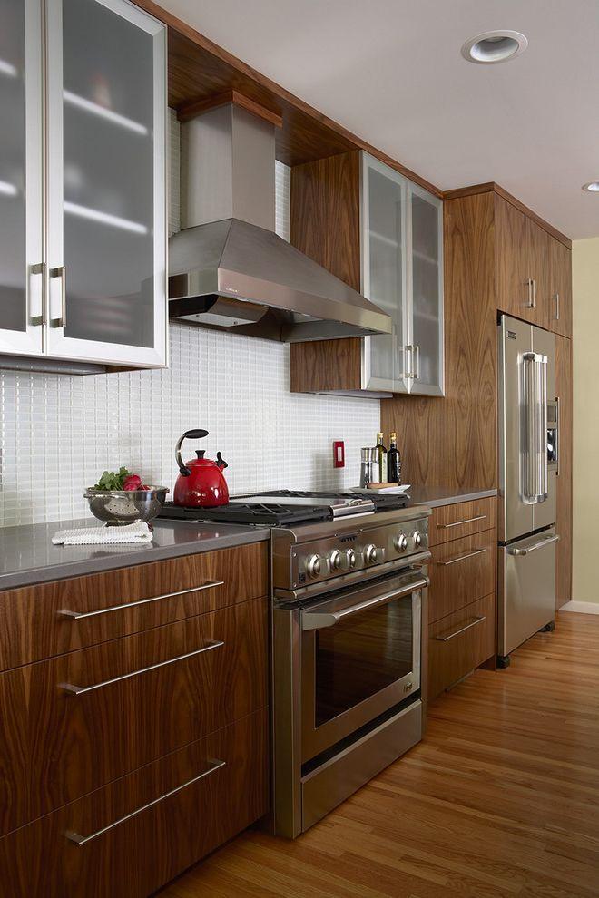 Walnut Ridge Cabinetry   Contemporary Kitchen Also Chrome Drawers Glass Tile Grey Led Lighting Range Hood Red Silestone Countertop Stainless Steel Tile Kitchen Backsplash Walnut Wood Flooring