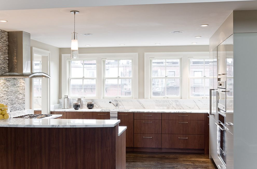 Walnut Ridge Cabinetry with Contemporary Kitchen  and Carrera Marble Glass Pendant Gray Tile Marble Counter Modern Kitchen Mosaic Natural Light Oak Cabinets Pendant Light Range Hood Stainless Steel Appliances Tile Backsplash