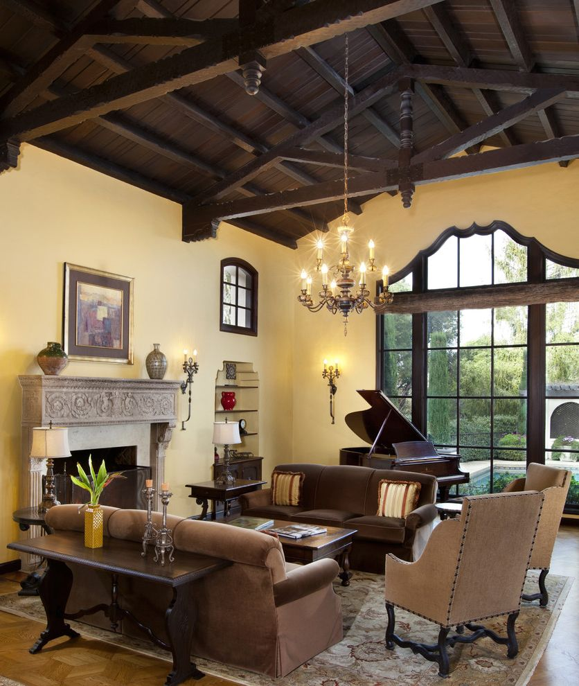Warm Yellow Paint Colors   Traditional Living Room Also Accent Window Arched Window Built in Bookcase Built in Bookshelves Chandelier Fireplace Rustic Ceiling Sofa Stucco Table Lamp Wood Beams Wood Ceiling Yellow Wall