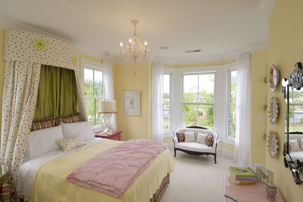 Warm Yellow Paint Colors with Traditional Bedroom  and Baseboards Bay Window Canopy Bed Chandelier Crown Molding Curtains Drapes Floral Pastel Colors Polka Dots Settee Wall Art Wall Decor Wall Plates White Wood Window Sheers Window Treatments Wood Trim