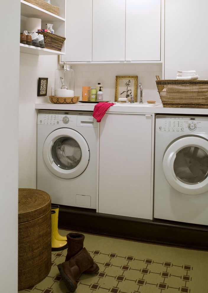 Washer and Dryer Platform   Contemporary Laundry Room Also Built in Storage Front Loading Washer and Dryer Small Space White Cabinets Wicker Laundry Hamper