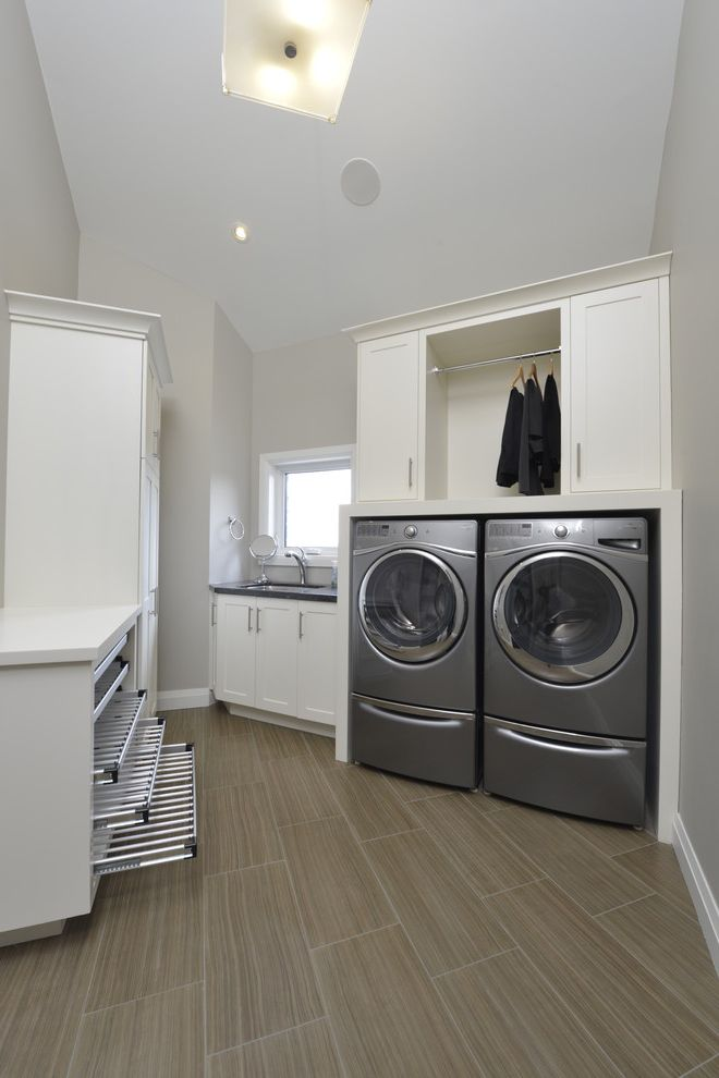 Washer and Dryer Platform   Contemporary Laundry Room  and Built in Cabinets Clean Laundry Room High Ceiling Laundry Room Sink Odd Shaped Room Pull Out Shelves Side by Side Washer and Dryer