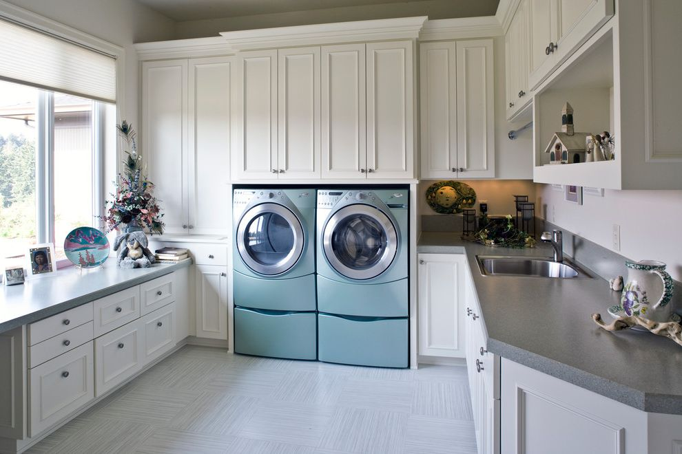 Washer and Dryer Platform with Traditional Laundry Room Also Blue Washer Dryer Cream Cabinets Front Loading Gray Counter Large Laundry Room Large Window Laundry Room Mud Room Square Tile Floor