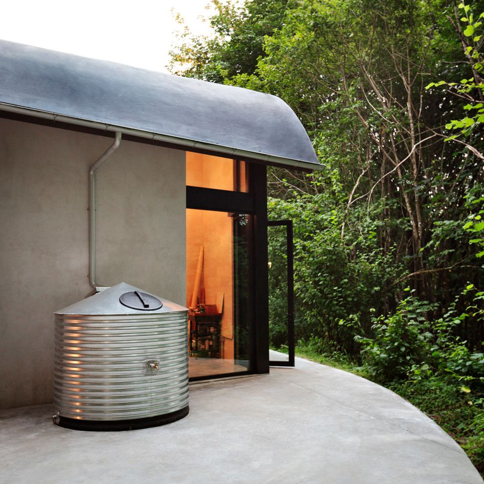 Water Holding Tank for House   Contemporary Exterior  and Aluminum Windows Cistern Concrete Patio Curved Roof Half Round Gutter Membrane Roof Metal Cistern Outdoors Rain Runoff
