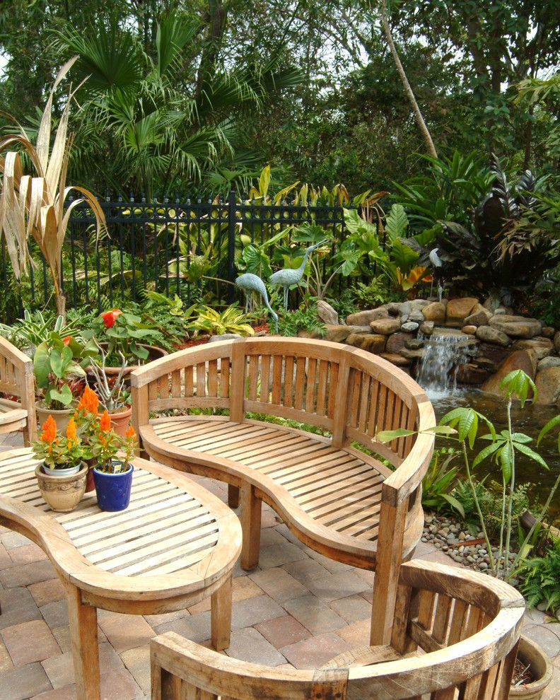 Waterfalls in Florida   Eclectic Landscape  and Amoeba Table Barrel Shaped Chair Brick Patio Heron Sculpture Palm Tree Patio Patio Furniutre Pond Slat Bench Tropical Water Feature Waterfall Wood Bench Wood Furniture
