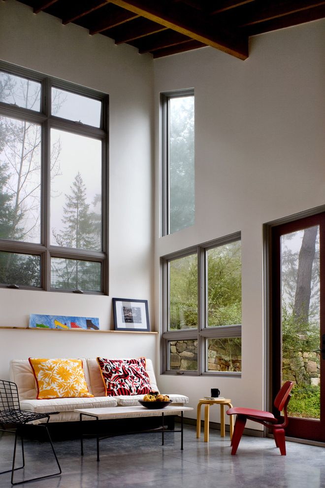 Wayfair Com Returns   Contemporary Living Room  and Built in Shelf Cathedral Ceiling Concrete Floor Daylight Exposed Framing Indoor Outdoor Loft Modern Icons Painted Ceiling Painted Doors Painted Walls Painted Windows Places for Art Wood Windows