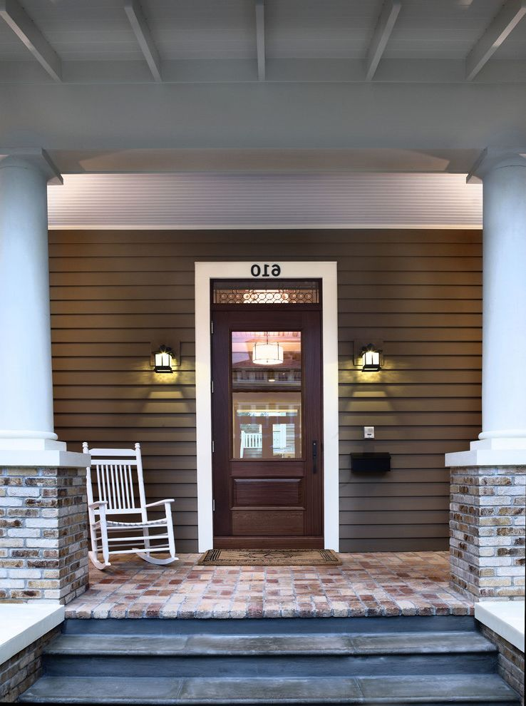 Weather Guard Door Mats with Craftsman Entry  and Address Numbers Brick Pavers Columns Covered Entry Floor Mat Front Door Glass Panel Door Lap Siding Mailbox Outdoor Sconce Porch Rocking Chair Stairs Steps Welcome Mat White Door Casing