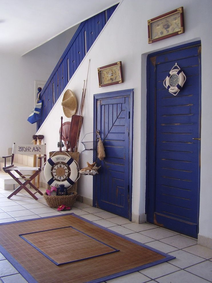 Weather Guard Door Mats with Eclectic Entry  and Accent Color Beach House Blue Blue Door Blue Rail Boat Cottage Railing Seaside Sisal Rug Stairs Tiled Floor White Floor White Tile