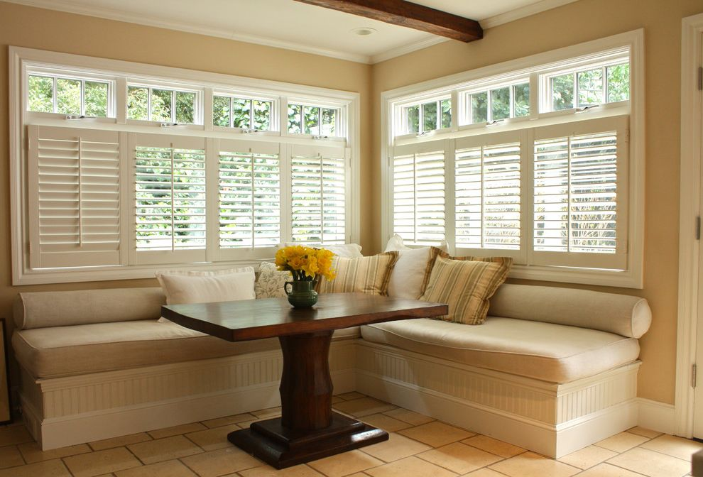 What Are Plantation Shutters with Traditional Dining Room  and Banquette Beadboard Breakfast Bar Breakfast Nook Eat in Kitchen Exposed Beams Floor Tile Neutral Colors Pedestal Table Plantation Shutters White Wood Window Treatments Wood Molding