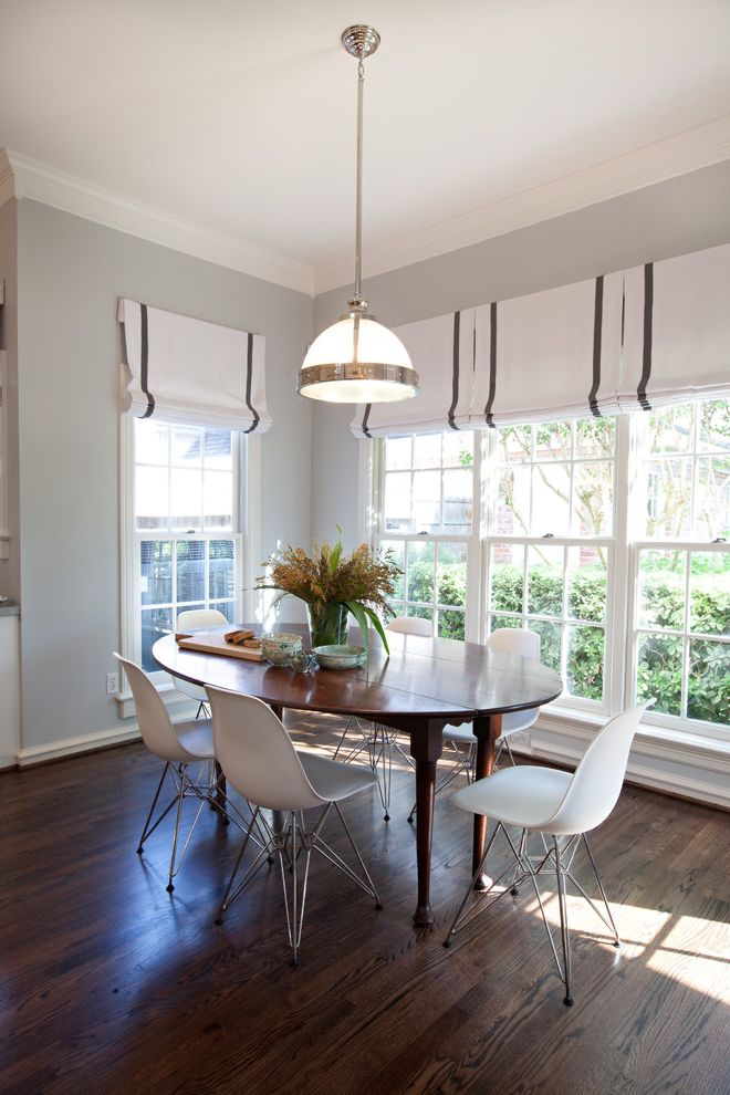 What Are Roman Shades   Contemporary Dining Room  and Centerpiece Eames Eiffel Chairs Gray Wall Hardwood Floor Muntins Oval Dining Table Pendant Light Roman Shades White Chairs White Window Trim Windows