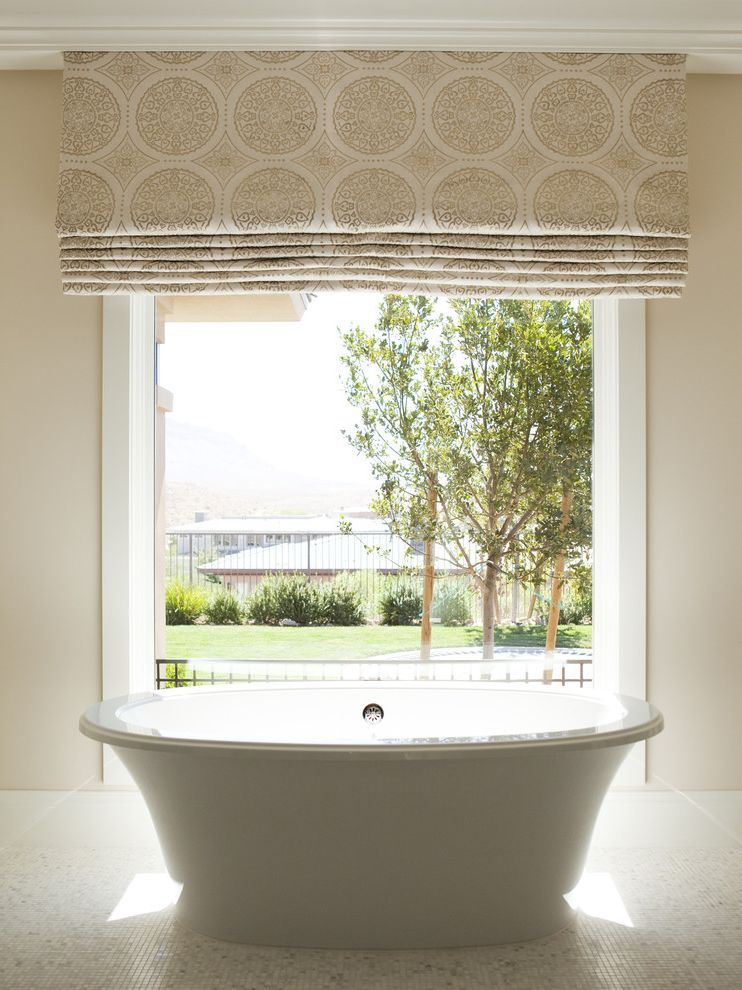 What Are Roman Shades with Modern Bathroom Also Beige Walls Freestanding Tub Master Bathroom Patterned Roman Shade Roman Shades Soaking Tub Tile Tile Floor View White Molding