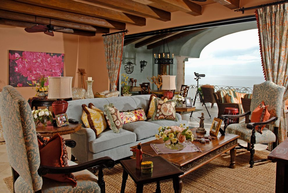 What Colors Go with Gray   Mediterranean Living Room  and Balcony Ceiling Beams Covered Patio Damask Drapes European Fuchsia Light Blue Natural Fiber Rug Sofa Terrace Throw Pillows Water View Wood Coffee Table