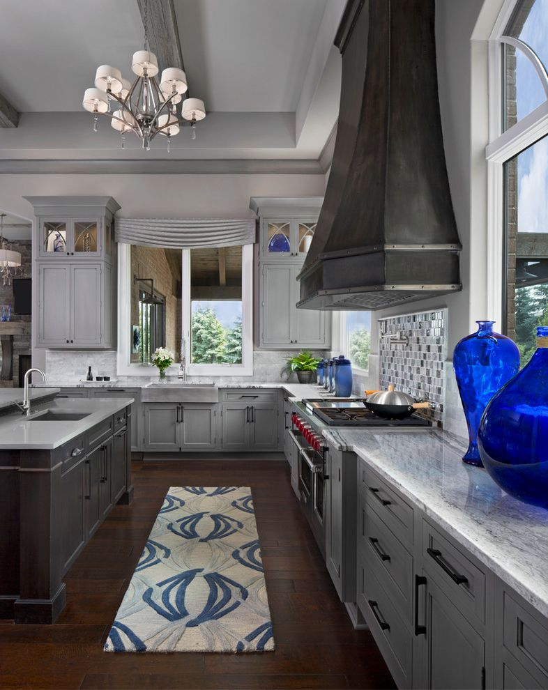 What Colors Go with Gray   Transitional Kitchen  and Cabinet Mullions Chandelier Gray and Blue Kitchen Marble Backsplash Marble Countertop Metal Range Hood Model Home Navy Blue Reclaimed Wood Beams Tin Rangehood Wood Flooring