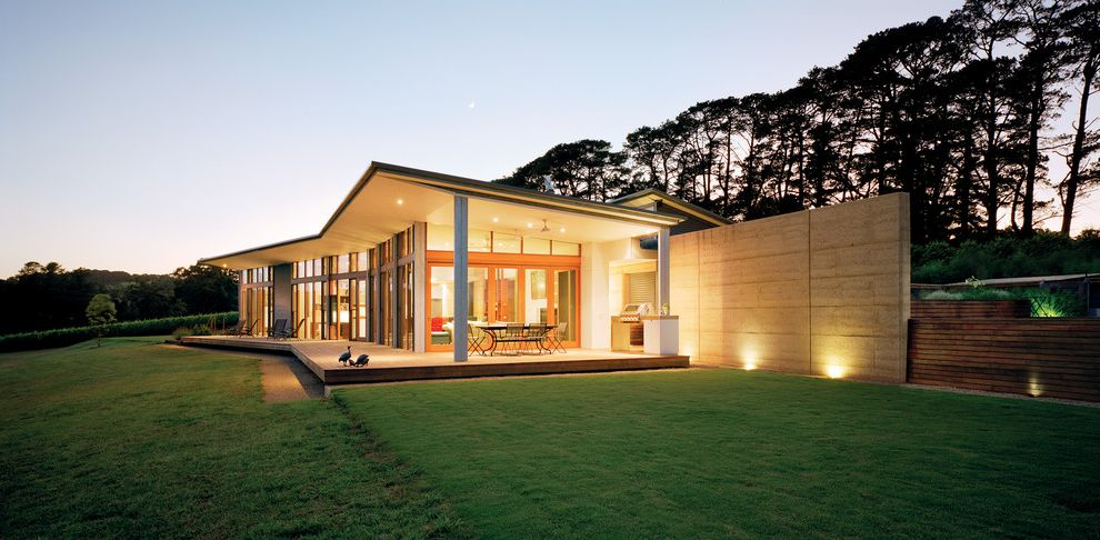 What Does Chagrin Mean with Modern Exterior Also Blade Wall Board Formed Concrete Covered Patio Deck Eaves Glass Grass Large Windows Lawn Outdoor Living Porch Lighting Rammed Earth Timber Wall Lighting Wood Fence Wood Trim