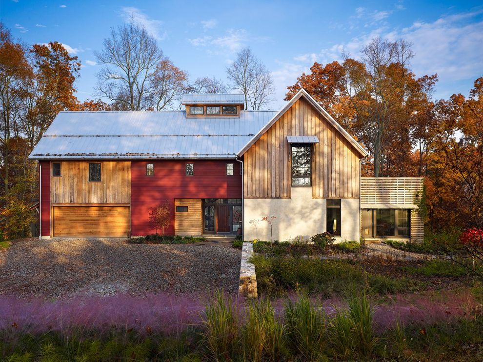 What Does Rough Mean with Farmhouse Exterior Also Barn Cupola Deck Grasses Metal Roof Mixed Siding Modern Barn Overhang Purple Flowers Red Siding Side Lites Standing Seam Roof Transom Vernacular Wood Garage Door Wood Siding