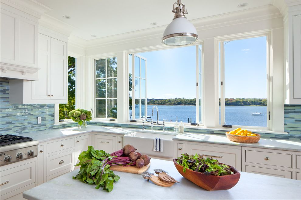 What is a Casement Window with Beach Style Kitchen  and Pendant Lights Row of Windows Water View White Kitchen