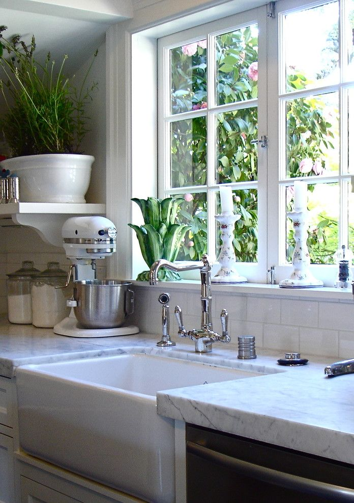 What is a Casement Window with Traditional Kitchen  and Deep Sink Farm Sink Kitchen Containers Kitchen Faucet Kitchen Mixer Kitchen Storage Kitchen Window Kitchenaid Mixer Potted Plant Salt Castor White Cabinets White Sink Window Ledge