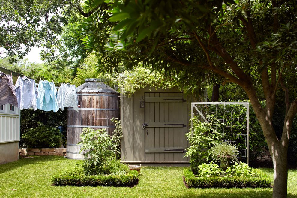 What is a Cistern with Farmhouse Landscape Also Clothes Line Herb Garden Rain Barrel Tool Shed