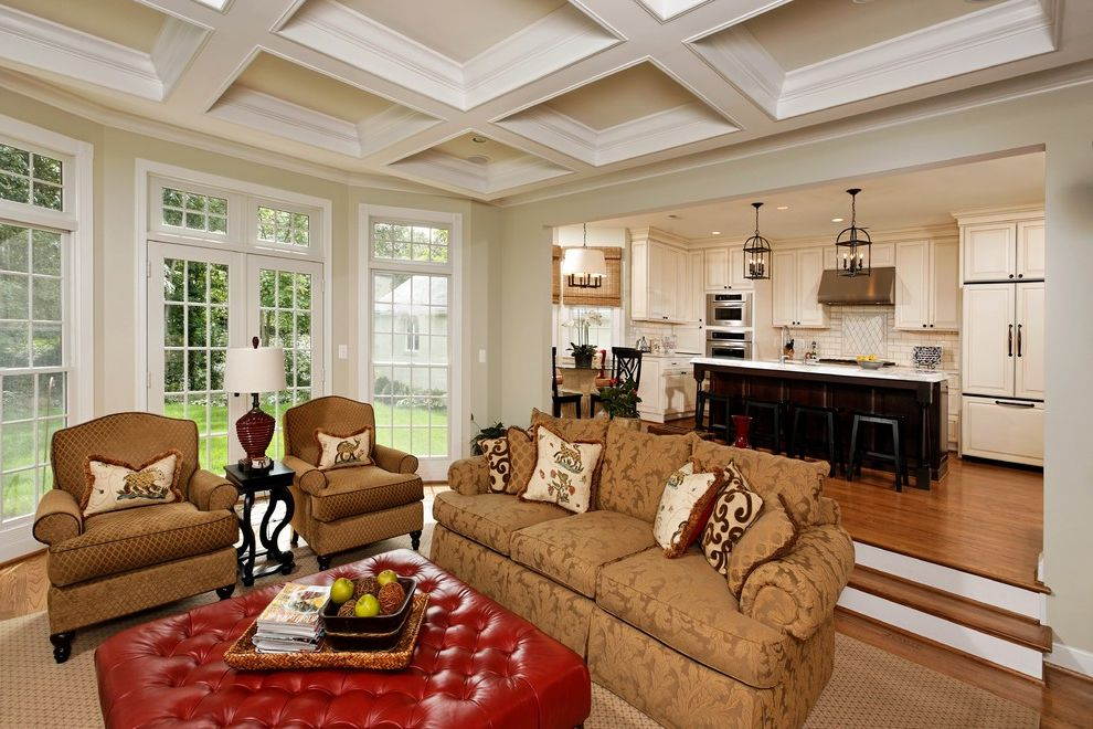 What is a Family Room   Traditional Family Room Also Area Rug Coffered Ceiling Damask French Doors Integrated Kitchen Red Leather Ottoman Sofa Steps Tile Backsplash Transom Windows Tufted Leather White Painted Wood Wood Floor