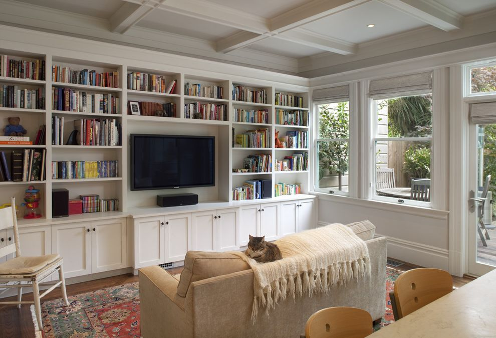 What is a Family Room with Traditional Family Room  and Bookcase Bookshelves Built in Shelves Built Ins Cat Ceiling Lighting Coffered Ceiling Great Room Media Storage Recessed Lighting White Wood Window Treatments Wood Molding