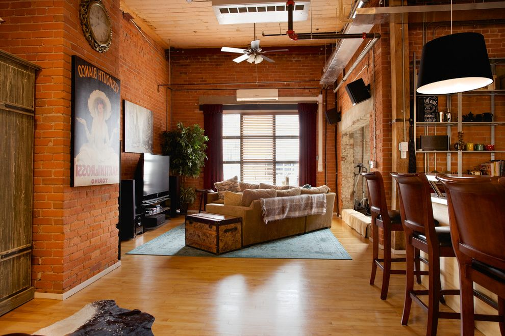 What is a Loft Apartment   Industrial Living Room  and Antique Mirror Bar Cabinet Bar Cart Bus Sign Converted Warehouse Cow Hide Rug Exposed Pipes Hard Loft Leather Chaise Loft Apartment